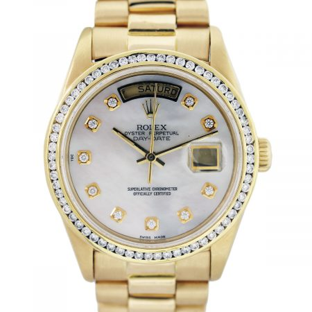 mother of pearl 18k gold rolex diamond bezel