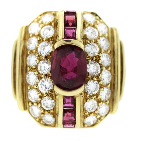 You are viewing this Vintage 18k Yellow Gold Ruby and Diamond Ring!