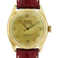 Vintage Rolex 6084 14kt Gold Champagne Dial on Red Leather Strap