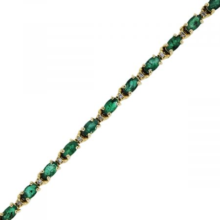You are viewing this yellow gold diamond and emerald tennis bracelet!