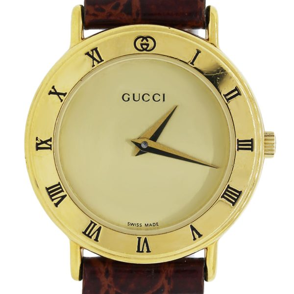 You are viewing this Vintage Gucci Gold Watch!