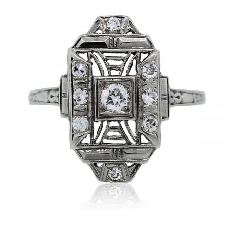You are viewing this 18k white gold diamond vintage ring!
