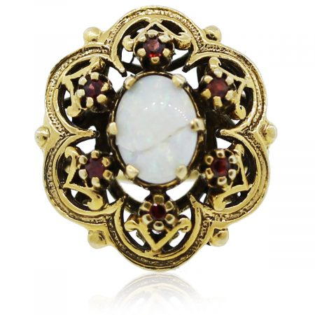 You are viewing this yellow gold opal and garnet ring!