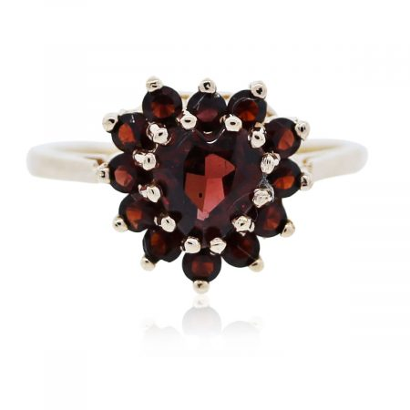 You are viewing this yellow gold and garnet heart shaped ring!!