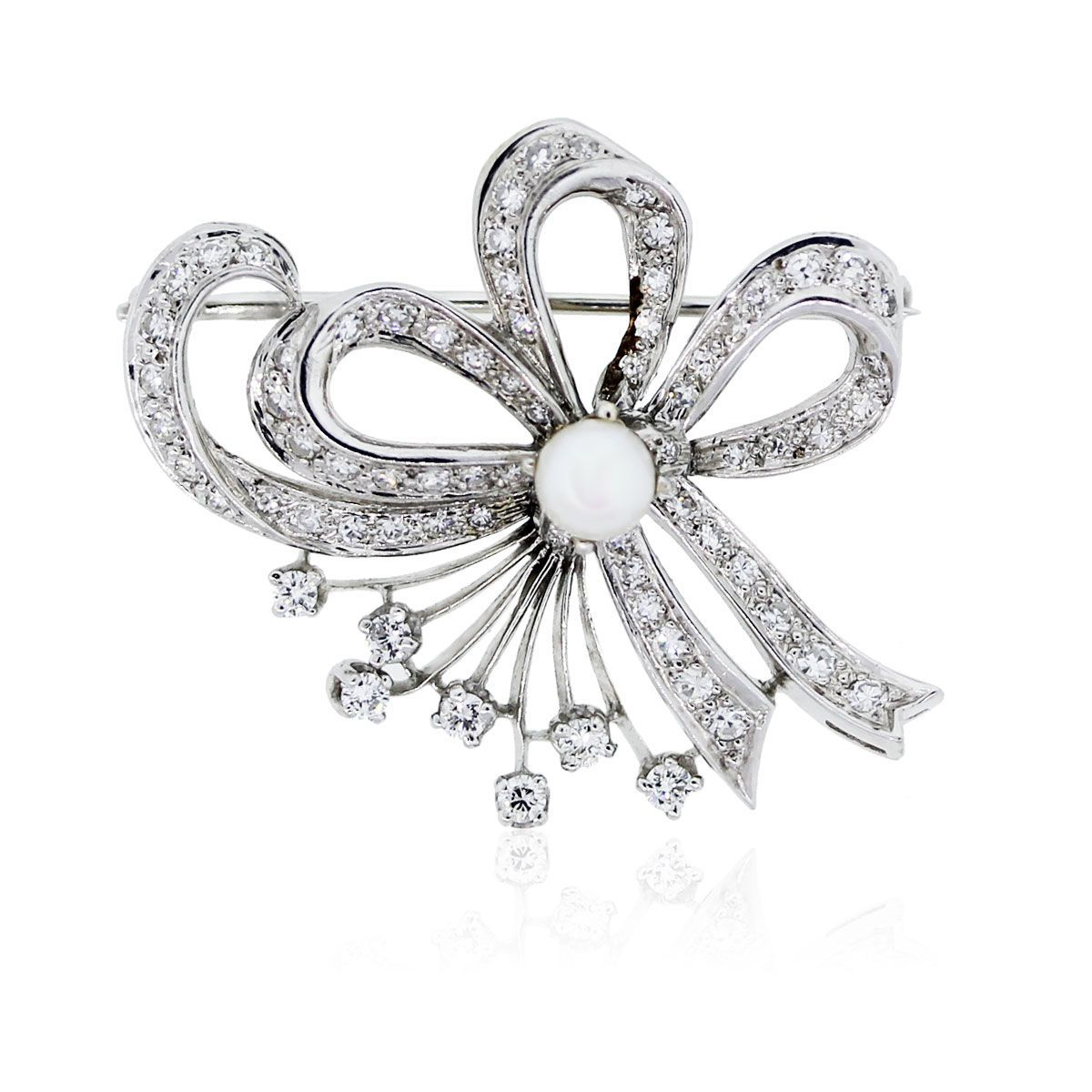 You are viewing this 14k White Gold With Diamonds and Pearl Pin!