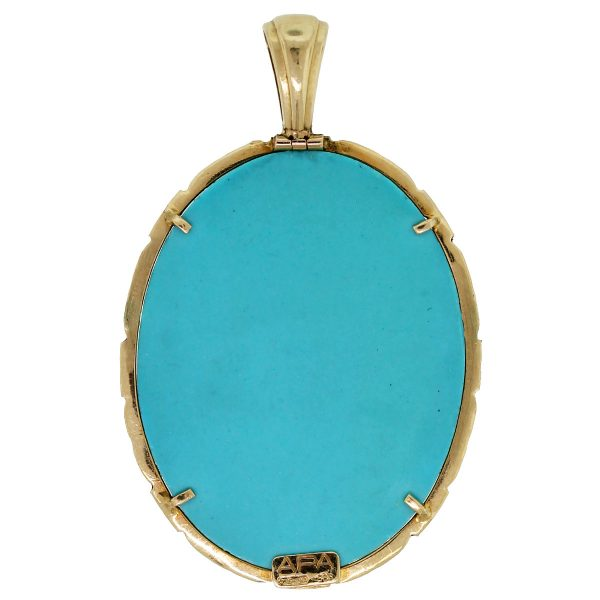 This 14kt Yellow Gold Simulated Turquoise Cameo Pendant is absolutely beautiful!
