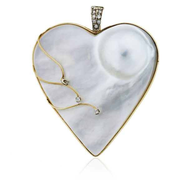 You are viewing this Yellow Gold Mobe Pearl and Diamond Heart Penant!