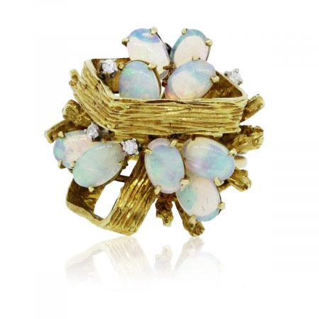 You are viewing this Yellow Gold Opal and Diamond Cluster Ring!