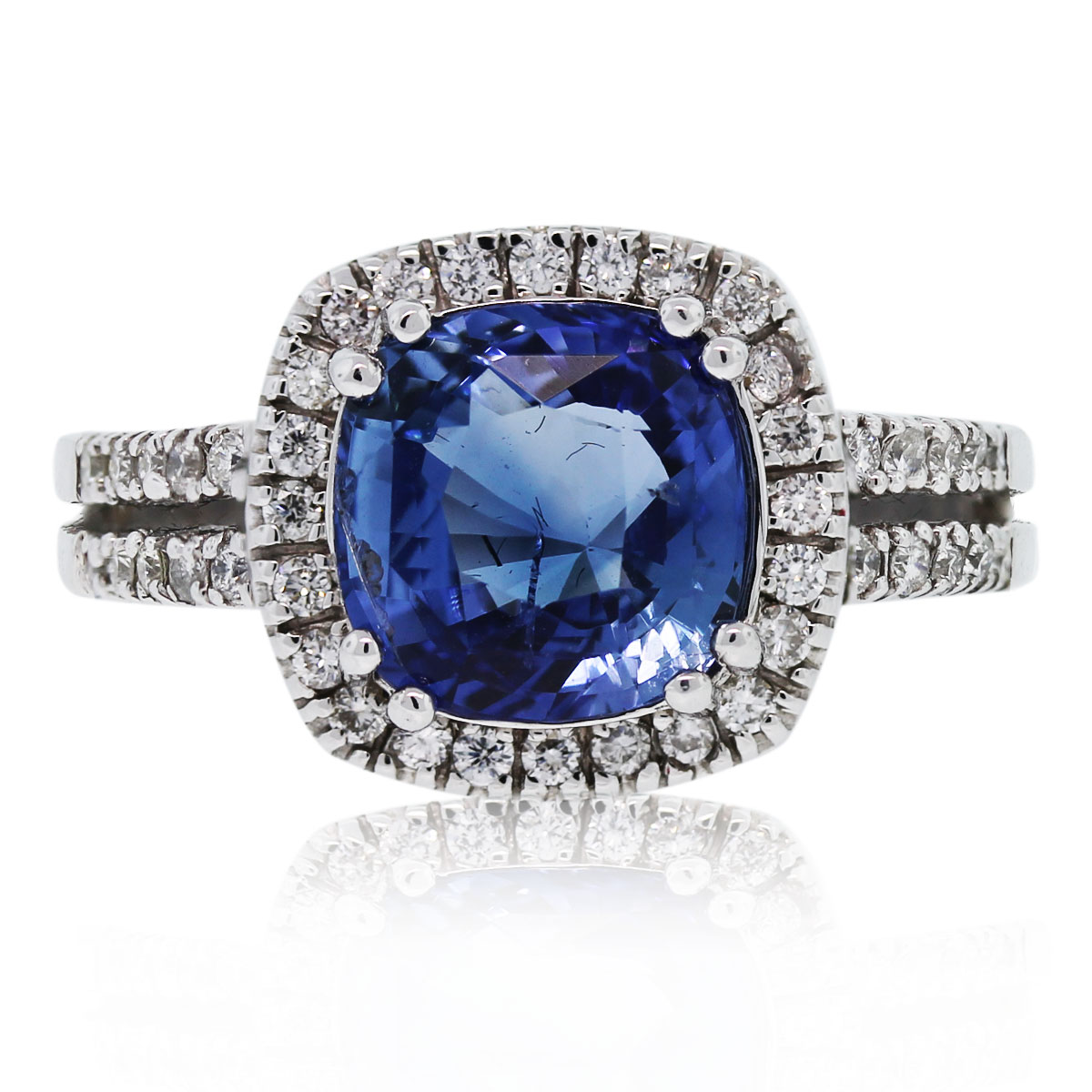 You must see this 18k White Gold Cushion Cut Sapphire & Diamond Ring