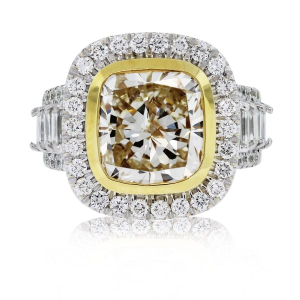 This 18kt Two Tone Fancy Yellow Cushion Cut Diamond Engagement Ring is stunning!