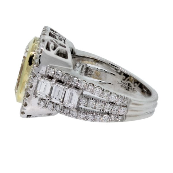 Check out this 18kt Two Tone Fancy Yellow Cushion Cut Diamond Engagement Ring