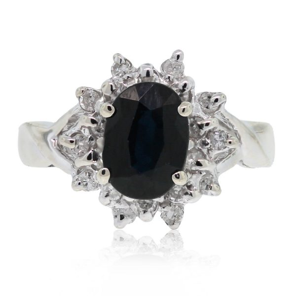 You are viewing this 14kt White Gold Oval Cut Sapphire & Diamond Flower Ring!