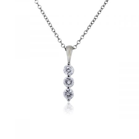 This 14k White Gold 3 Round Cut Diamond Pendant and Necklace is in Excellent Condition!
