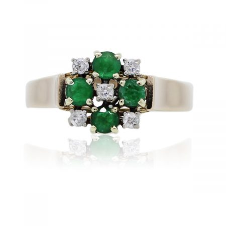 You are viewing this 14k Yellow Gold Diamond and Emerald Ring!