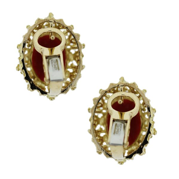 Check out these 18kt Yellow Gold Coral Floral Stud Earrings!