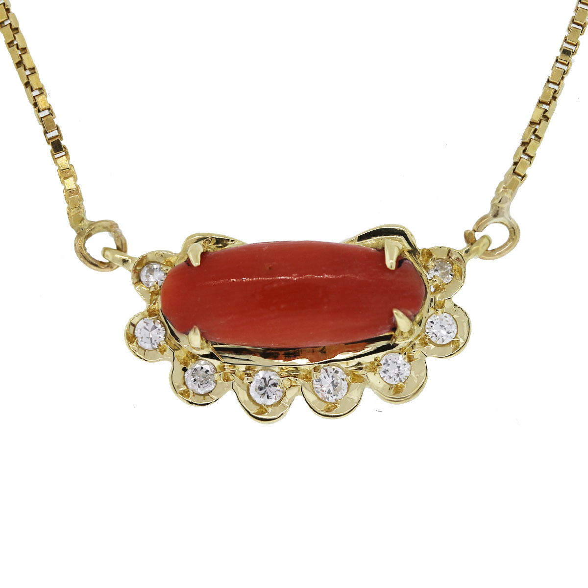 We love this 18kt Yellow Gold Cabochon Coral and Diamond Necklace