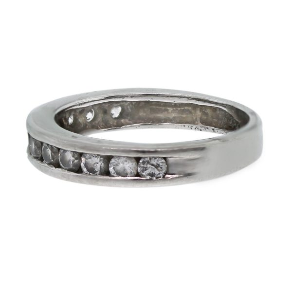 This 14k White Gold Invisibly Set Round Diamond Wedding Band is the perfect wedding band