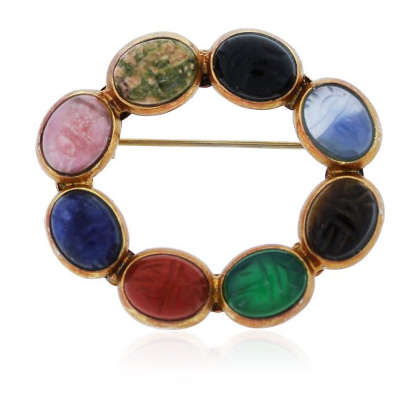 This Gold Plated Multi Colored Semi-Precious Carved Gemstone Pin is so pretty