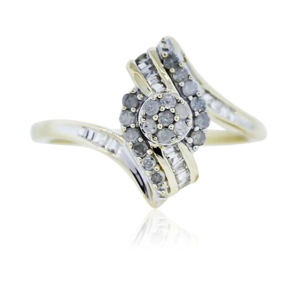You are vieweing this Yellow Gold Round and Baguette Diamond Cluster Ring!