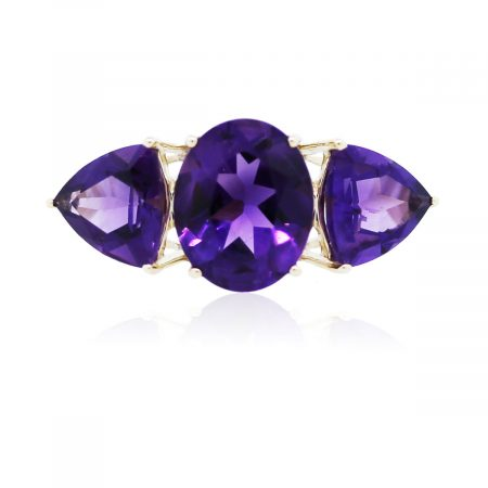 You are viewing this Yellow Gold Trillion and Oval Amethyst Three Stone Ring!