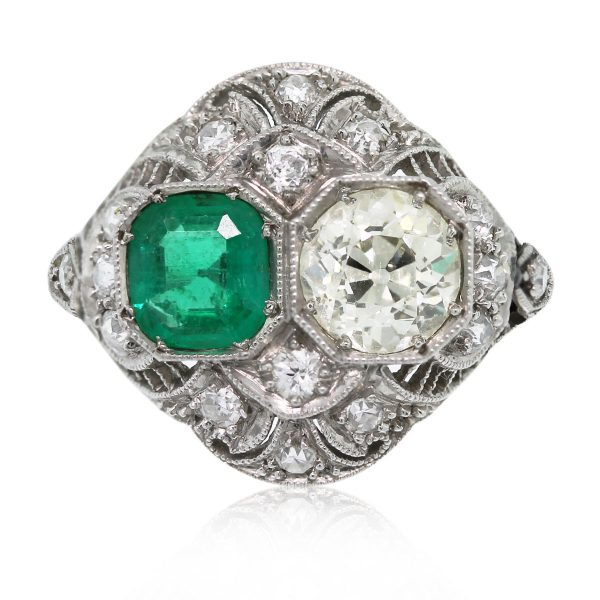 This Vintage Platinum Old European Cut Diamond and Emerald Ring is stunning!