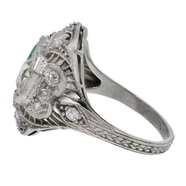 You must have this Vintage Platinum Old European Cut Diamond and Emerald Ring!