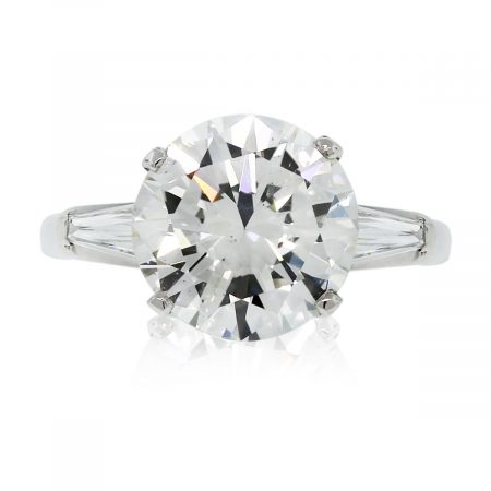 This Platinum EGL Certified Round Brilliant & Baguette Diamond Engagement Ring is stunning!