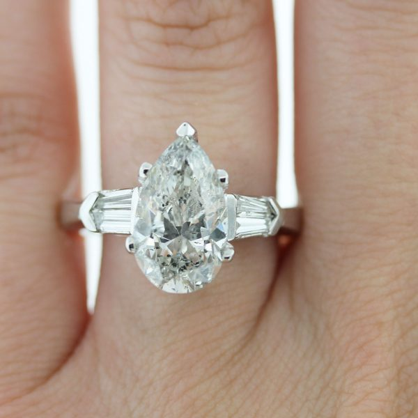 You must have this Platinum 3.47ct Pear Shape & Baguette Diamond Engagement Ring!