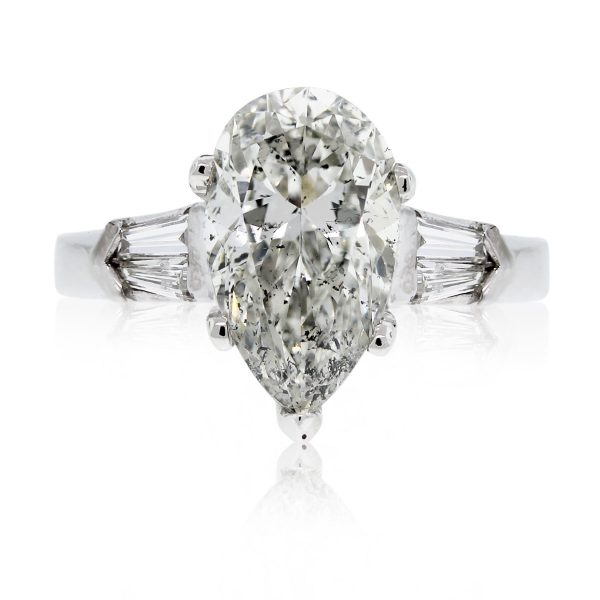 This Platinum 3.47ct Pear Shape & Baguette Diamond Engagement Ring is stunning!