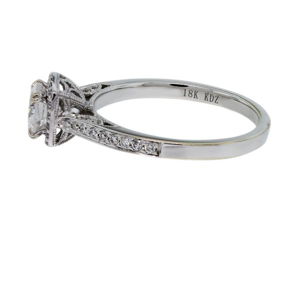 You must see this Platinum Round Brilliant Diamond Halo Engagement Ring