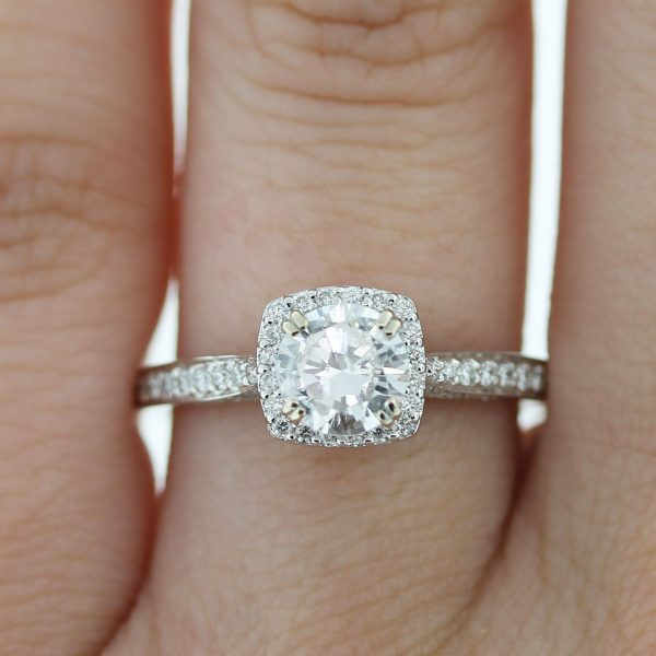 Check out this Platinum Round Brilliant Diamond Halo Engagement Ring