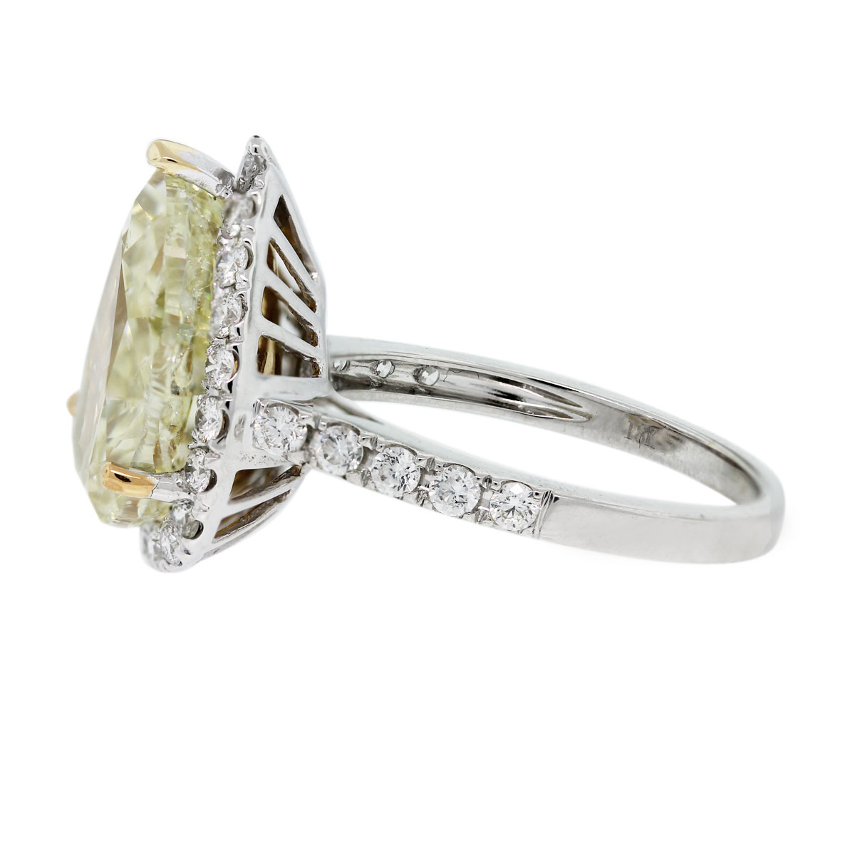 You'll love this 18k White Gold Pear Shape Fancy Yellow Diamond Halo Engagement Ring