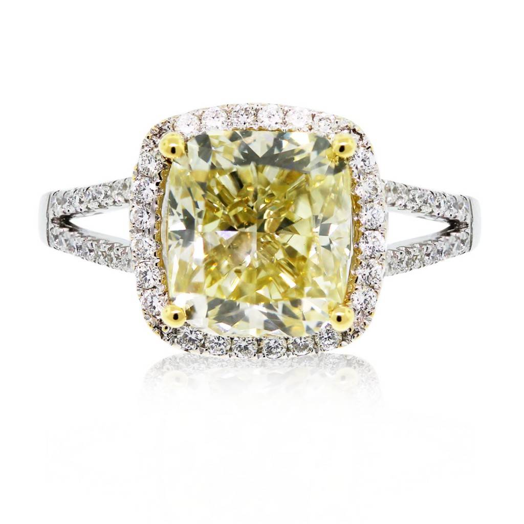 This split shank cushion cut fancy yellow diamond engagement ring is gorgeous!