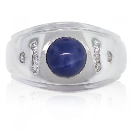 This 14k White Gold Linde Star Sapphire and Diamond Men's Ring is gorgeous