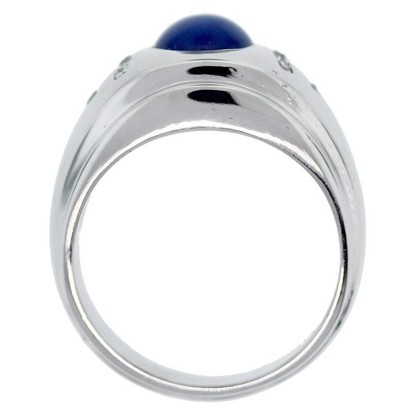This 14k White Gold Linde Star Sapphire and Diamond Men's Ring needs to be yours!