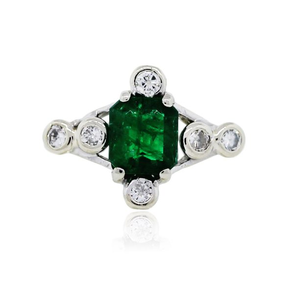 You are viewing this 14k White Gold Emerald and Diamond Ring!