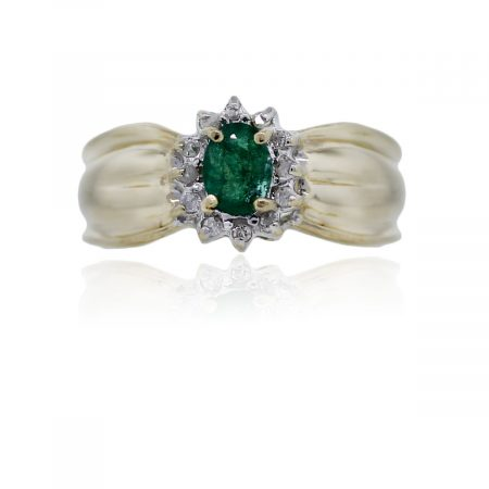 You are viewing this 14k Yellow Gold Emerald and Diamond Cluster Ring!