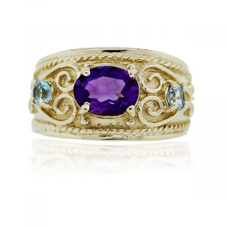 You are viewing this 10k Yellow Gold Amethyst and Blue Topaz Cocktail Ring!