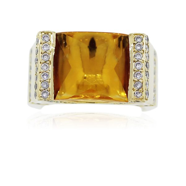 You are viewing this 18k Yellow Gold Radiant Citrine and Diamond Cocktail Ring!