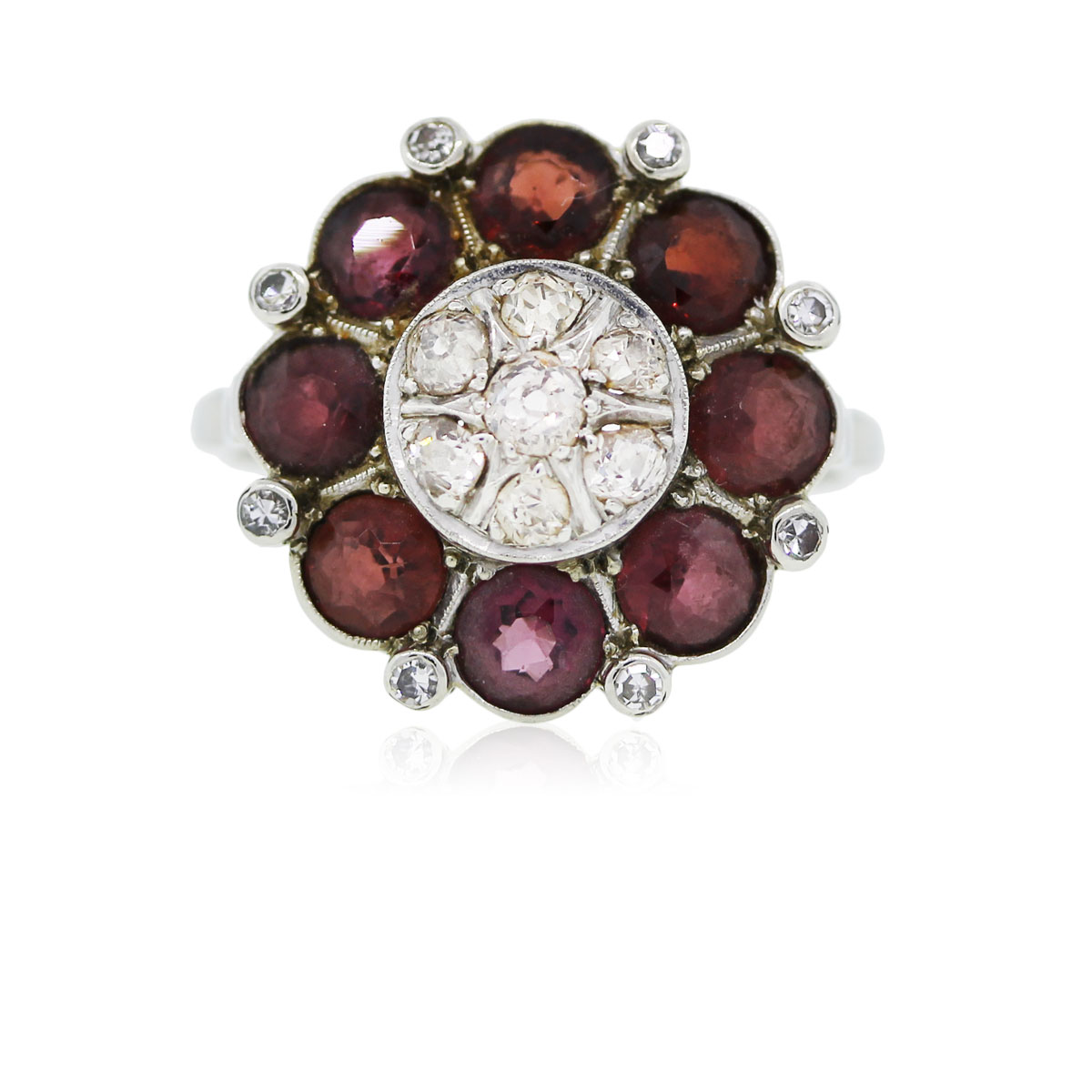 You are viewing this 18k White Gold Round Garnet Diamond Cocktail Ring!