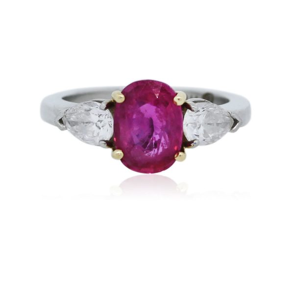 You are viewing this Pink Sapphire and Diamond Platinum 3 Stone Ring!