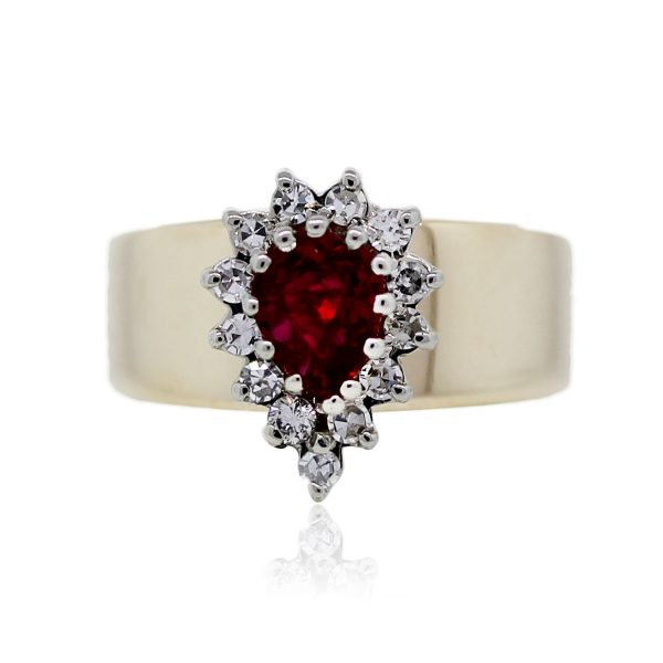 You are viewing this 14k Yellow Gold Diamond Ruby Pear Shape Ring!