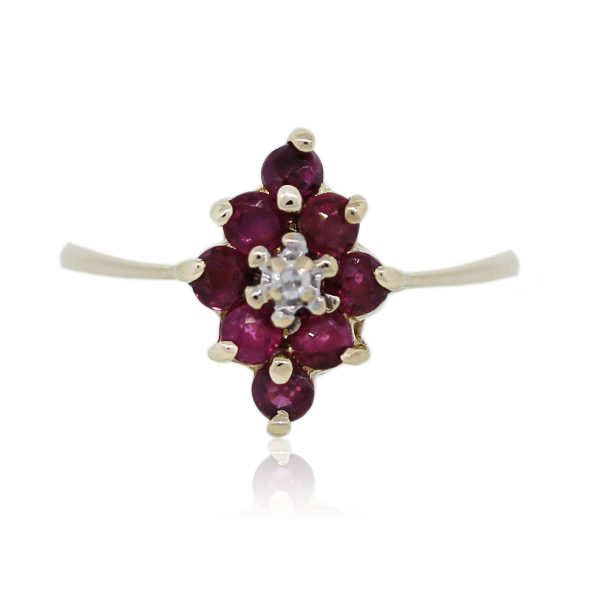 You are viewing this Yellow Gold Ruby and Diamond Cluster Cocktail Ring!