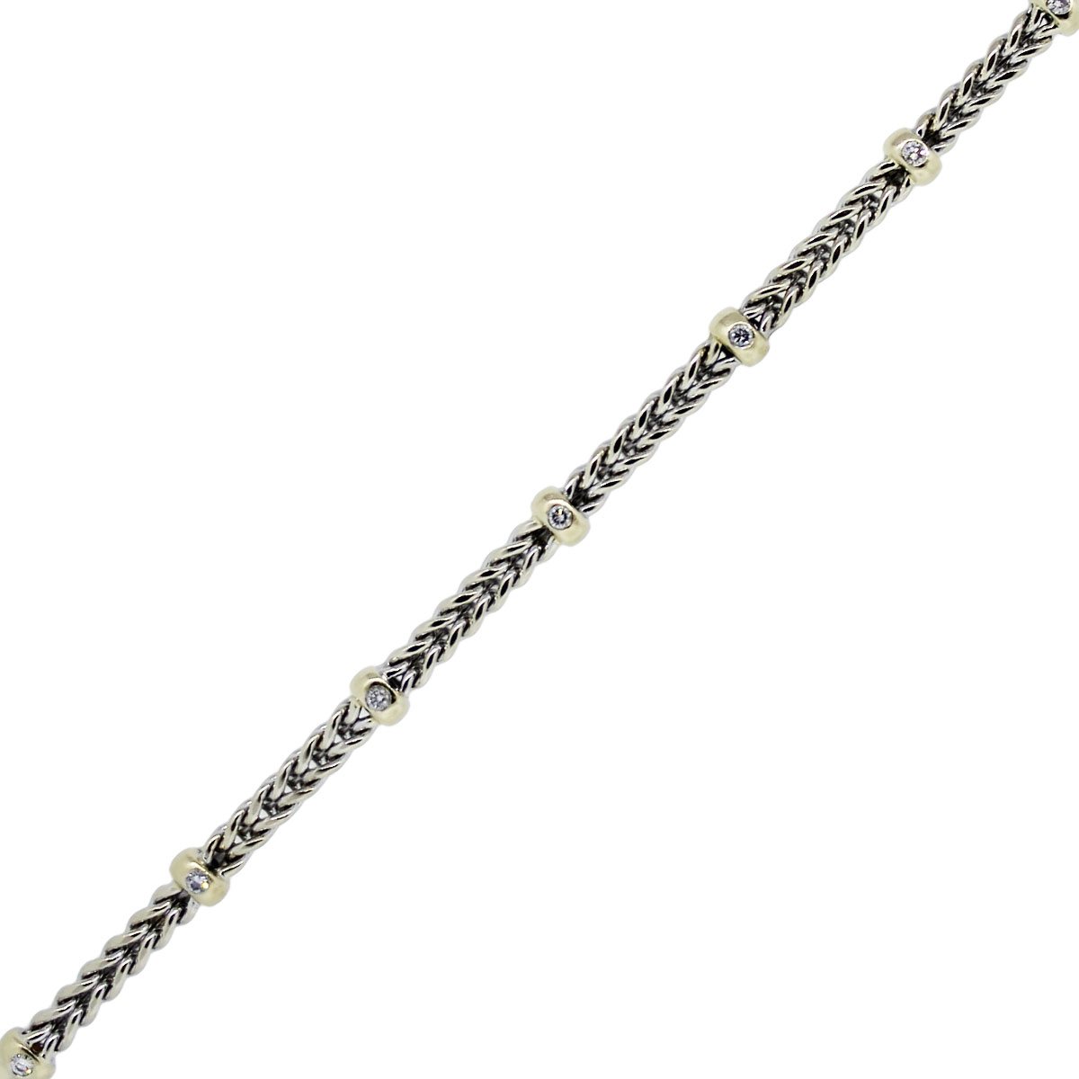 You are viewing this 14k Two Tone Diamond Accents Woven Bracelet!