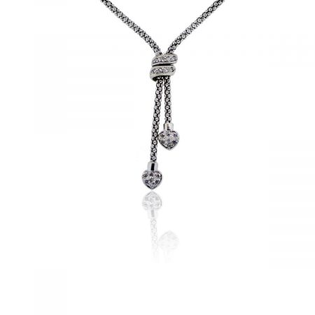 You are viewing this 14K White Gold Diamond Hearts Lariat Necklace!
