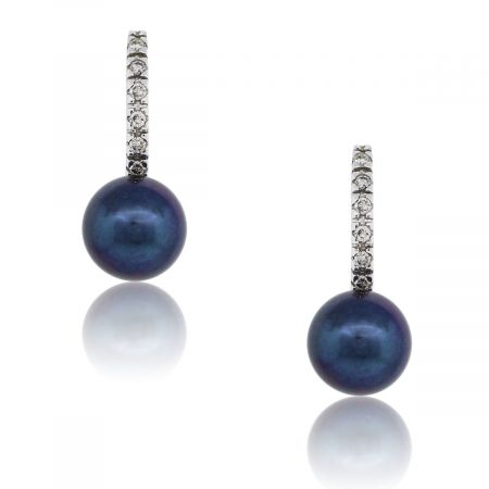 You are viewing these 14k White Gold Diamond Pearl Dangle Earrings!
