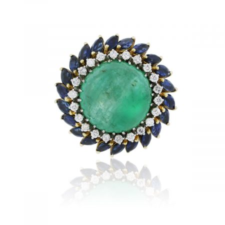 You are viewing this 18k Yellow Gold Cabochon Emerald, Diamond and Sapphire Cocktail Ring!