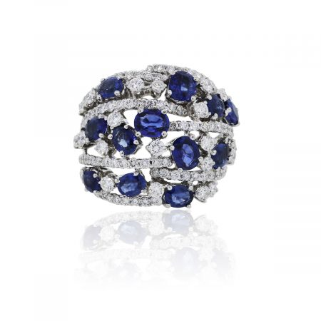 You are viewing this 18k White Gold Diamond and Sapphire Cluster Cocktail Ring!