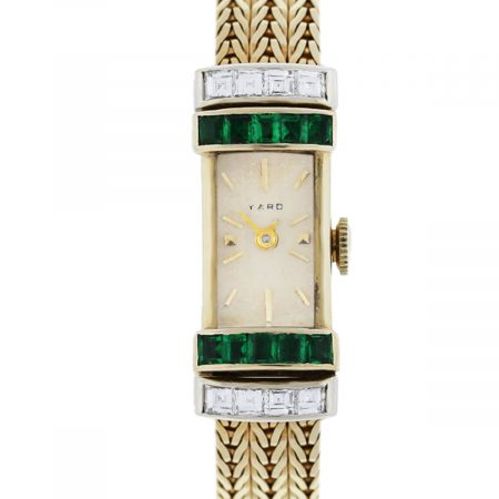 You are viewing this Raymond Yard 14k Yellow Gold Diamond and Emerald Ladies Wrist Watch!