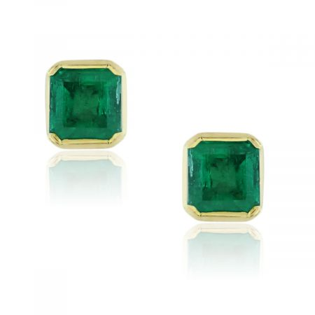 You are viewing these 18k Yellow Gold Princess Cut Colombian Emerald Stud Earrings!